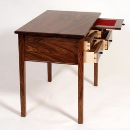 walnut table with drawerss opens